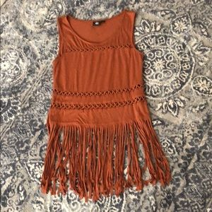 Tan tank with fringe and cut out detail.